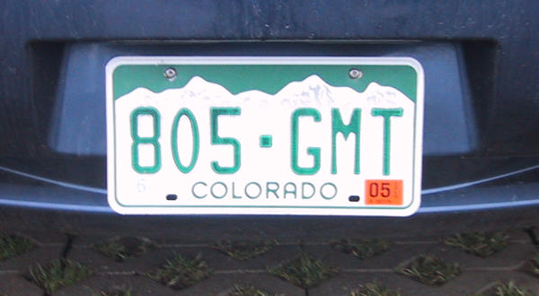 At the bottom of the plate is colorado in green capitals the background shows a silhouette of the rocky mountains at the top