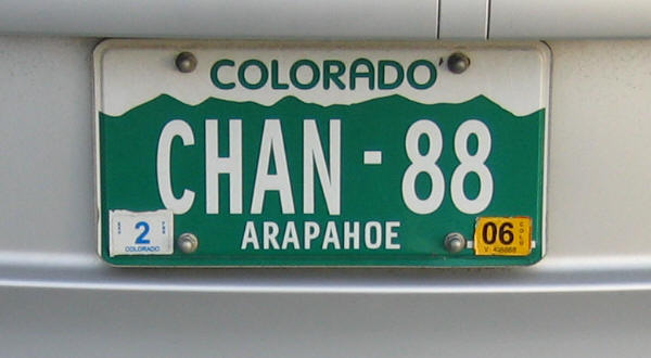 The registration consists of four letters followed by a hyphen and two numerals at the top of the plate is colorado in